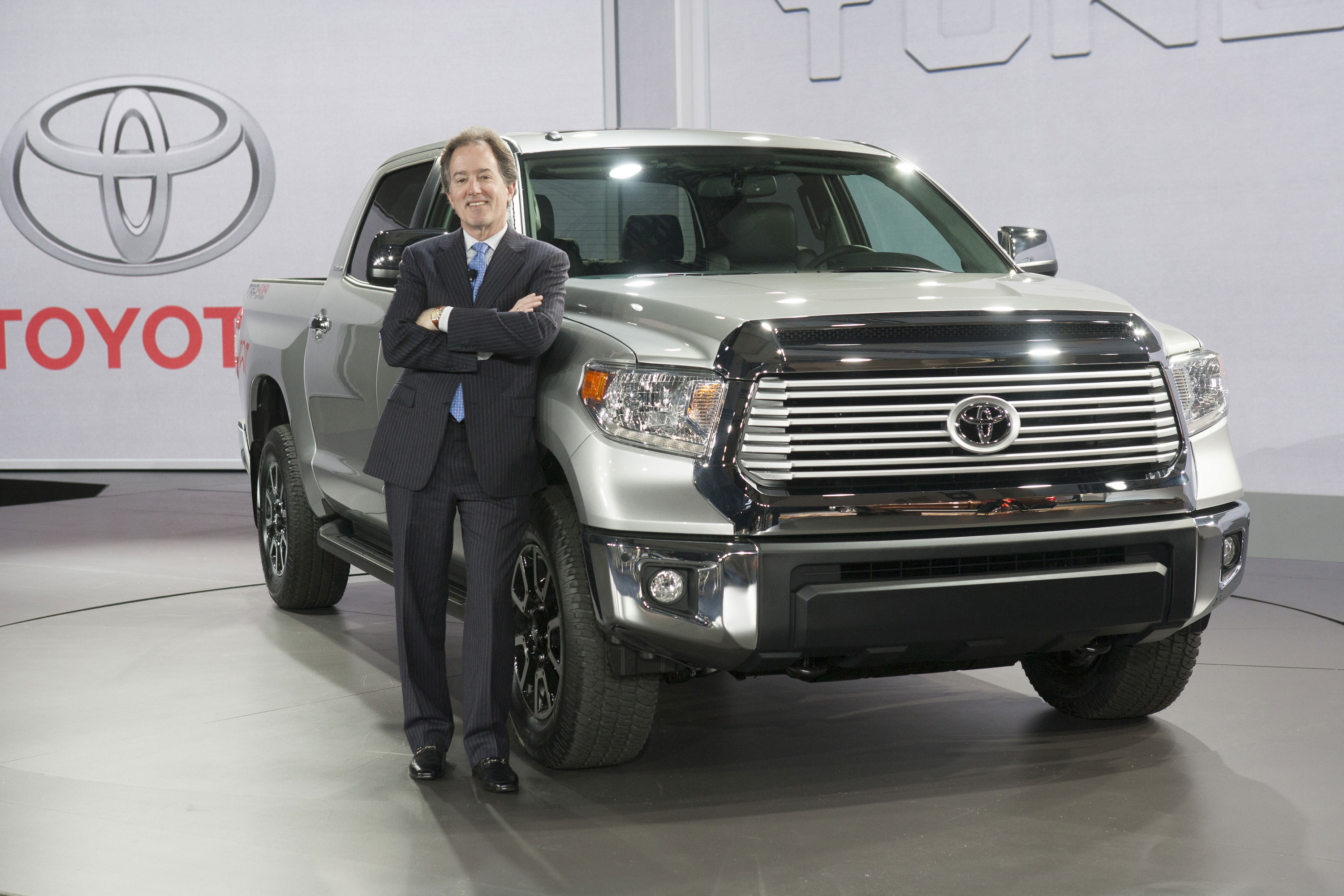 Bill Fay, Toyota Division group vice president and general manager, poses with the redesigned 2014 Tundra full-size pickup truck prior to its unveiling at the 2013 Chicago Auto Show.