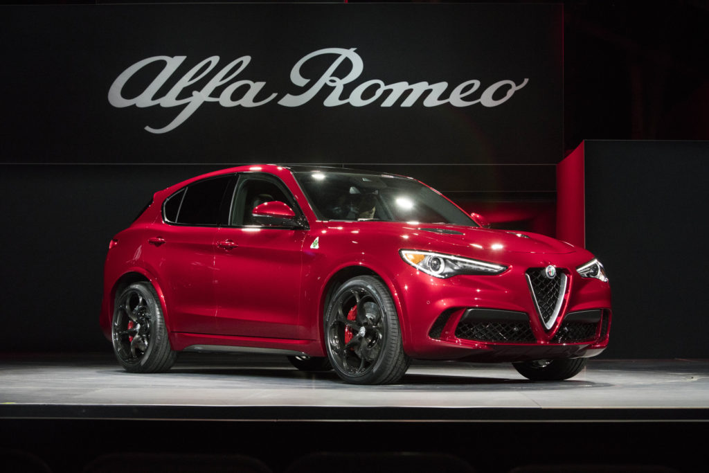 "Reid Bigland, Head of Alfa Romeo, reveals the all-new 2018 Alfa Romeo Stelvio in front of global media at the 2016 L.A. Auto Show. Stelvio Quadrifoglio – the ""halo"" model in the lineup – continues to highlight Alfa Romeo's performance and motorsport expertise with a best-in-class, Ferrari-derived 505 horsepower engine, powering it from 0-60 mph in just 3.9 seconds with a top speed of 177 mph. On sale in 2017, all Stelvio models come standard with the innovative Q4 all-wheel-drive-system."